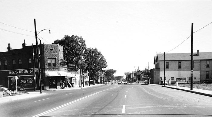 Looking east down Poplar Avenue at High Street in Memphis around 1955. The distinctive twin gable home on the right shows up in the background of the Vanity Fair photo.