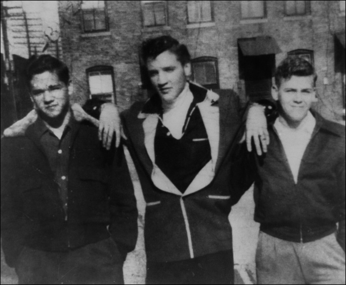 Elvis and Buzzy Forbess and Farley Guy hang out at Lauderdale Courts in 1954. Elvis' career was growing by the time this picture was taken.