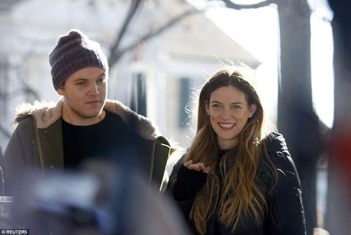 Elvis Presley's grandchildren Ben Keough (L) and Riley Keough stand in front of Graceland January 8, 2015.