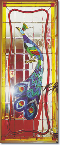 Peacock stained glass inside the living room of graceland.