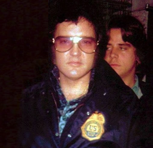 Elvis wearing his prized DEA badge.