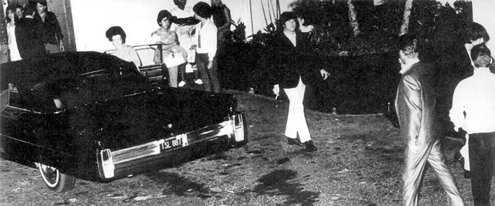 The Beatles meet Elvis Presley.