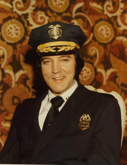Elvis Presley, as an honorary captain in the Denver police force. (Courtesy of Robert C. Cantwell).