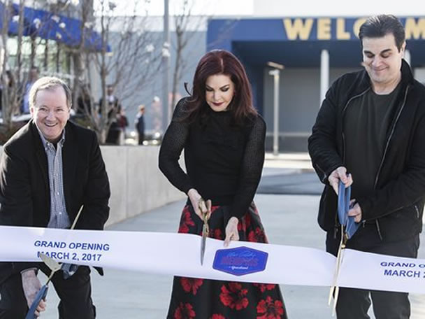 Priscilla Presley cuts the ribbon to open 'Elvis Presley's Memphis'.