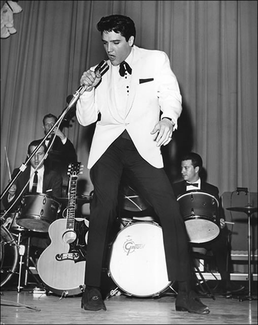 Elvis performs at Ellis Auditorium in 1961. After the show, he hosted a party at Graceland.