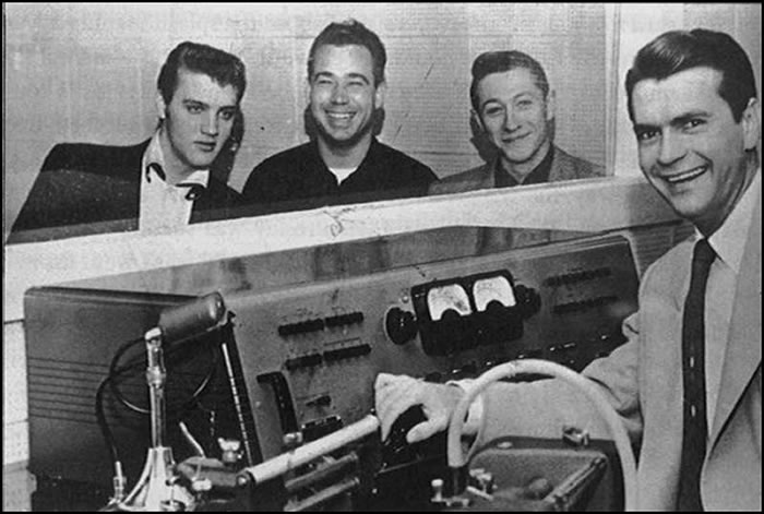 Elvis Presley, Bill Black, Scotty Moore and Sam Phillips at Sun Records, February 3, 1955.