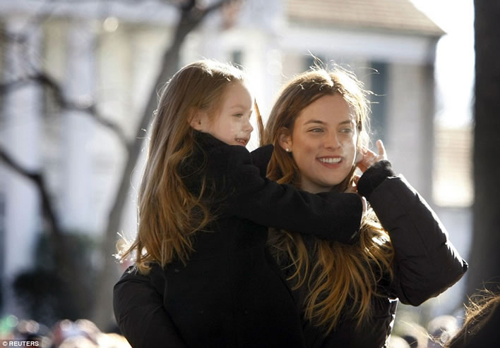 Riley Keough holds her little sister Finley Lockwood in front of Graceland January 8, 2015.