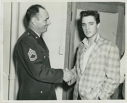 Ginger was five years old when her father met Elvis as a Public Relations Officer in the army in Memphis. This is her dad with Elvis.