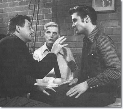 Hal Kanter, Lizabeth Scott and Elvis Presley on the set of 'Loving You'.