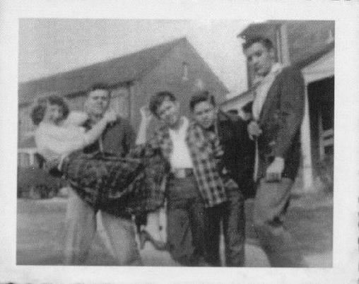 A young pre-fame Elvis hanging out with pals in Memphis (possibly Lauderdale Courts).