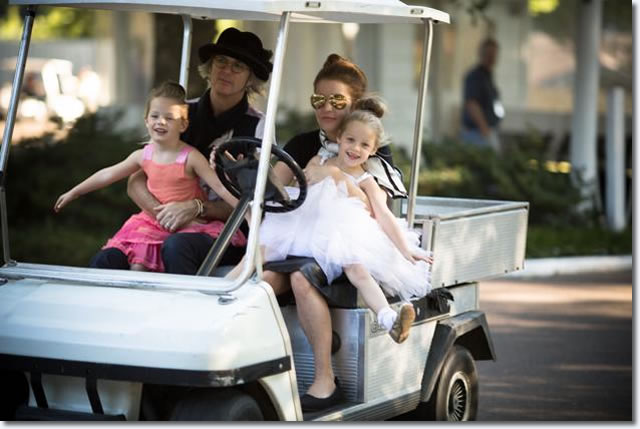 Lisa Marie with husband, Michael Lockwood take Elvis' grand children, their children for a go cart spin around the grounds of Graceland, as Elvis and Lisa used to do.
