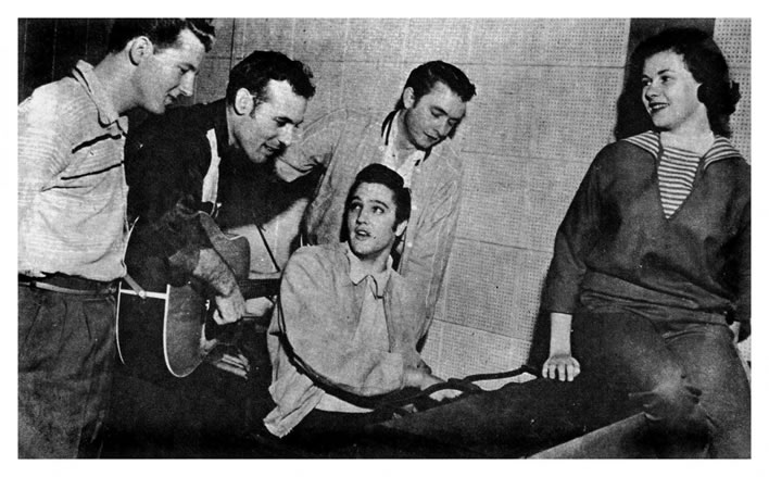 The 'Million Dollar Quartet'. Jerry Lee Lewis, Carl Perkins, Johnny Cash, Elvis Presley, (With Elvis' date, Marilyn Evans). December 4, 1956.