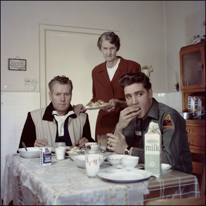 Minnie Mae, center, serves her son, Vernon, and her grandson, Elvis, who at the time was both a superstar and a member of the U.S. Army, in Germany.