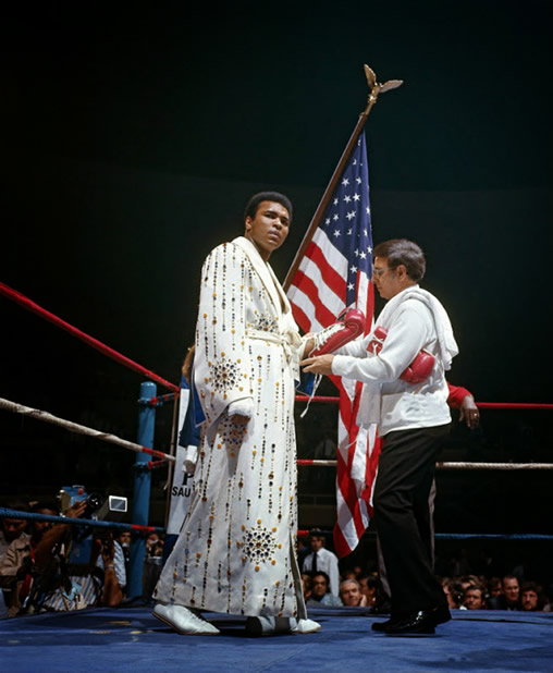 Muhammad Ali wearing the robe and Elvis Presley had given him. vs Ken Norton March 31, 1973.