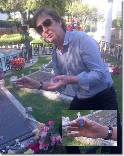 Paul McCartney at Elvis' grave, he is posing as he is holding one of is personalised guitar picks that he is about to leave, 'so Elvis can play in heaven'.