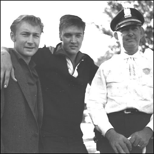 Elvis hangs out with Nick Adams, left, and Captain Woodward.
