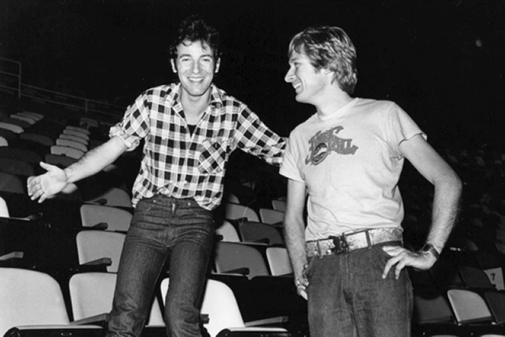 The Two Bruces — 'B.J.' and 'The Boss' — sharing a laugh and a quick break from one of their legendary soundcheck walks at Madison Square Garden in August 1978. Photograph courtesy of Bruce Jackson.