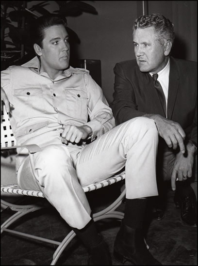 Elvis and Vernon Presley on a movie set.