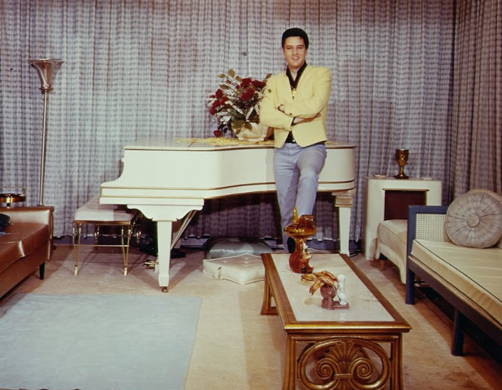 Elvis Presley with his piano at Graceland.