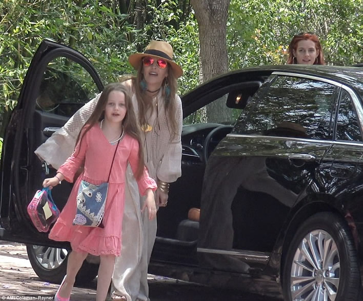 All the king's women: Lisa Marie Presley was photographed on May 29 arriving at the home of her mother Priscilla with her oldest daughter Riley Keough.