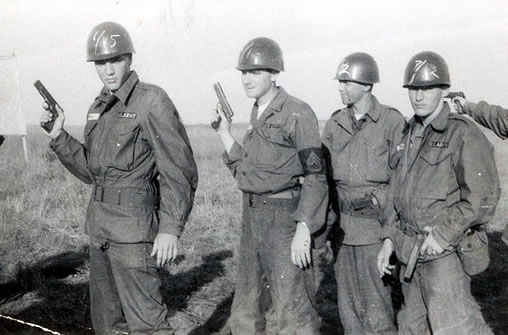 Elvis Presley, with hand gun, in the U.S. Army.
