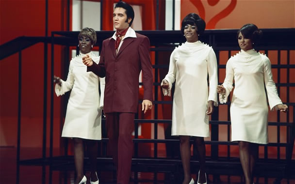 Elvis Presley performs with the Blossoms featuring Darlene Love (far right) on his 1968 Comeback Special.